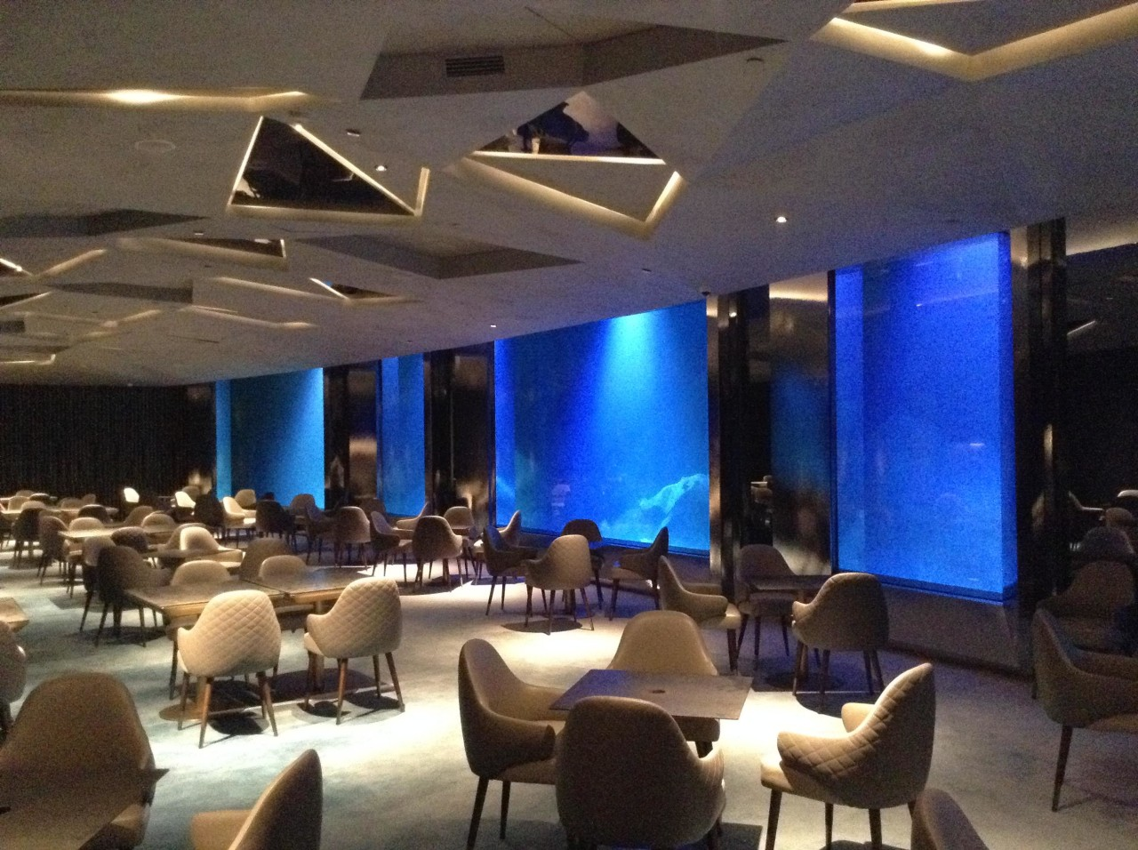 The two lowest levels are under water, with architecture, building, ceiling, conference hall, convention, convention center, design, function hall, interior design, lighting, property, resort, restaurant, room, black