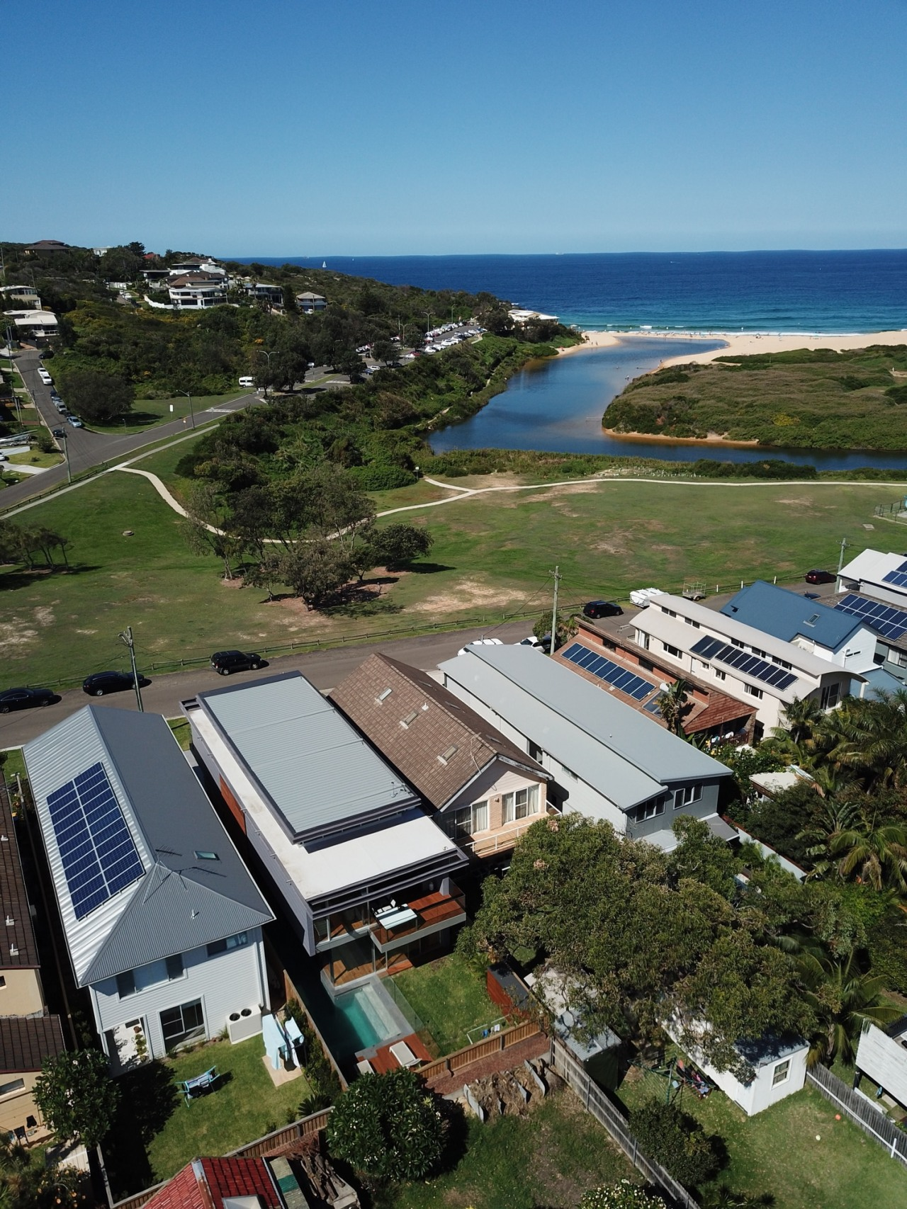 Looking out to see from the subdivision. aerial photography, bird's eye view, energy, home, house, photography, real estate, roof, sea, sky, water, brown
