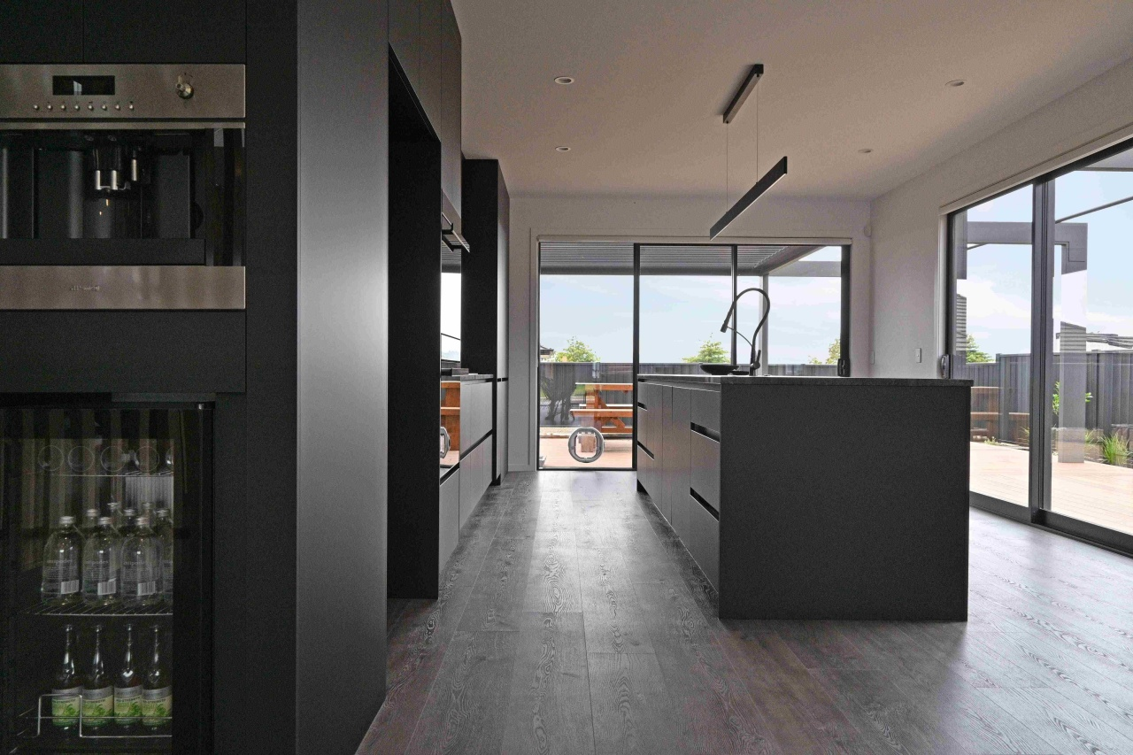 Recessed pulls contribute to the kitchen's minimalist look.