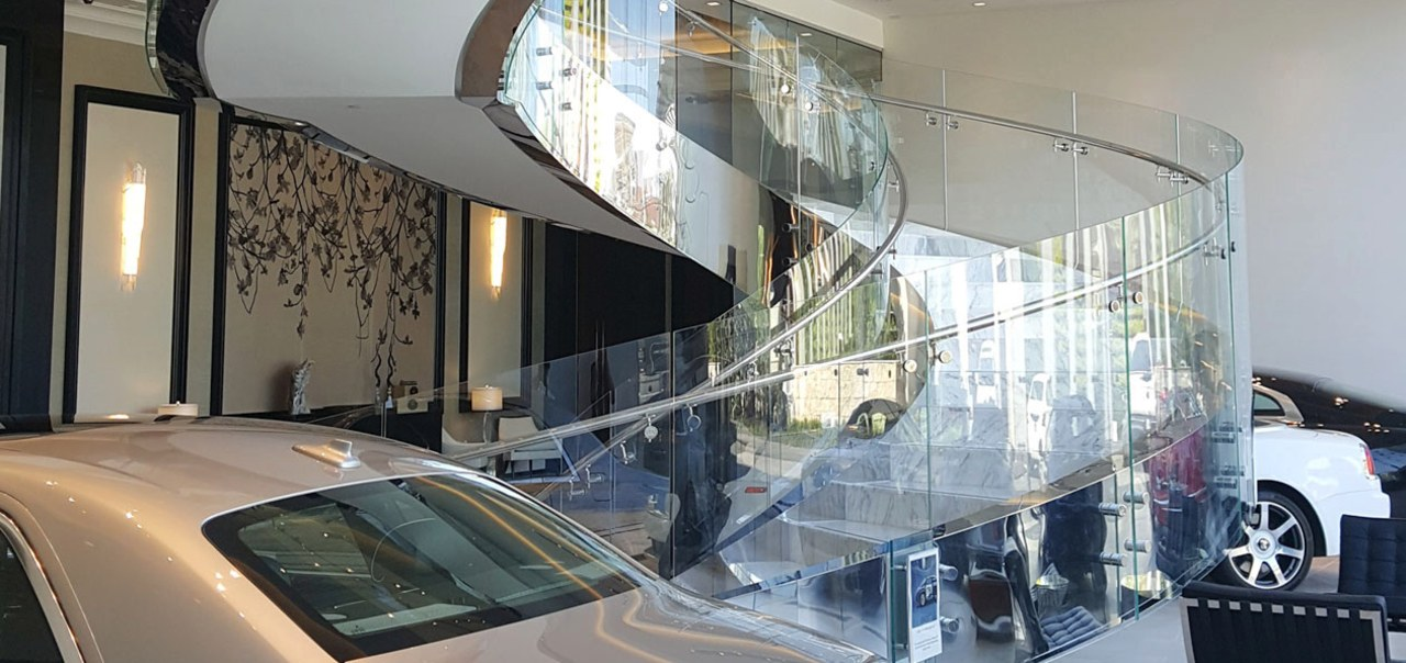 Rolls Royce Houston 1 - architecture | building architecture, building, car, facade, glass, interior design, lobby, transparent material, vehicle, vehicle door, gray