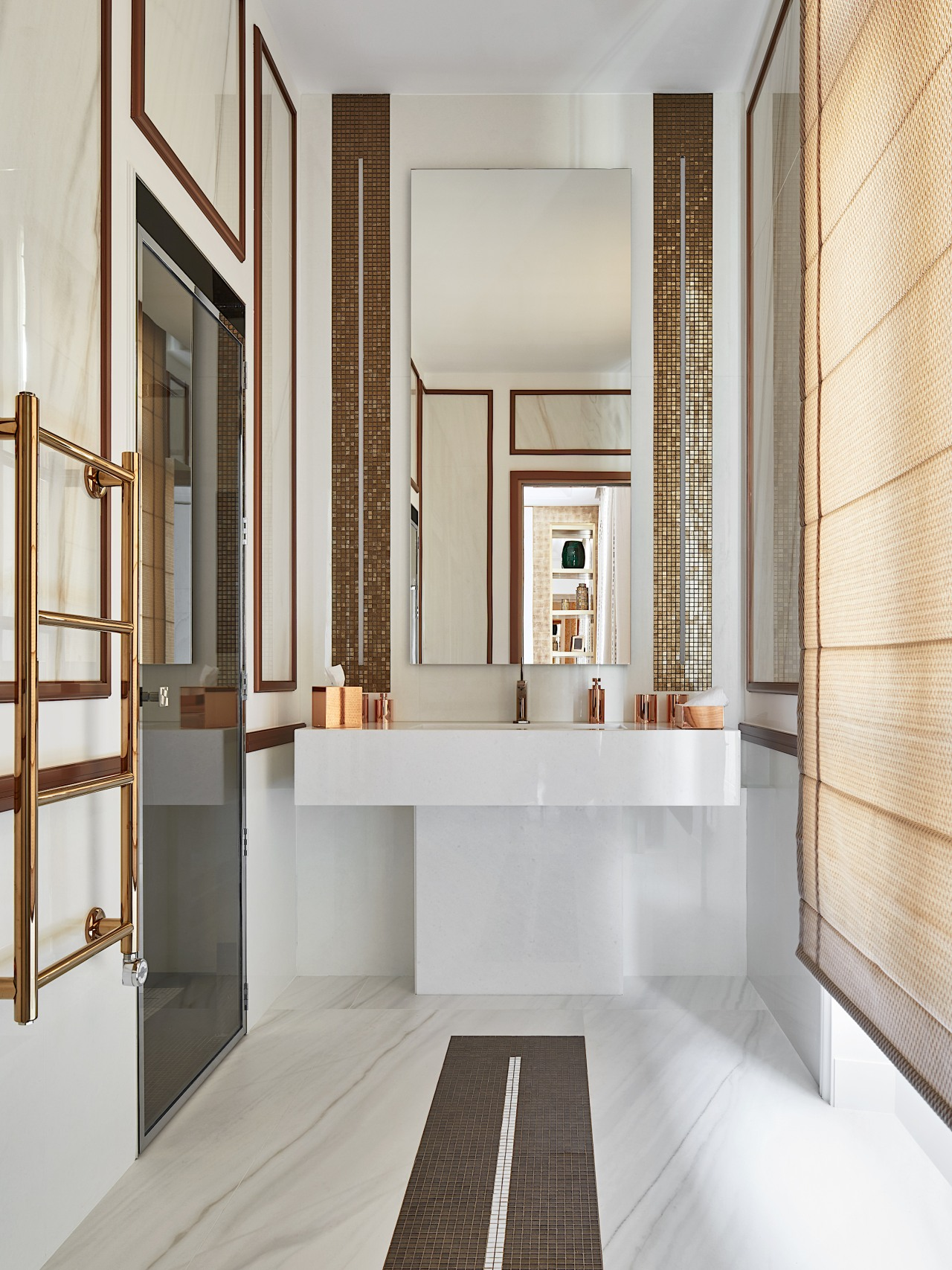 This bathroom celebrates a harmonic balance between marble gray