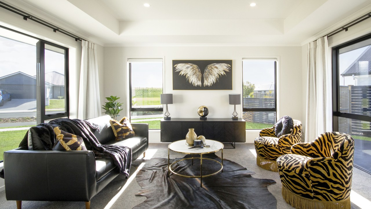 A grand cove ceiling sets the scene for