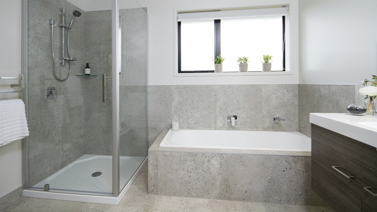 The family bathroom includes a tub and concrete