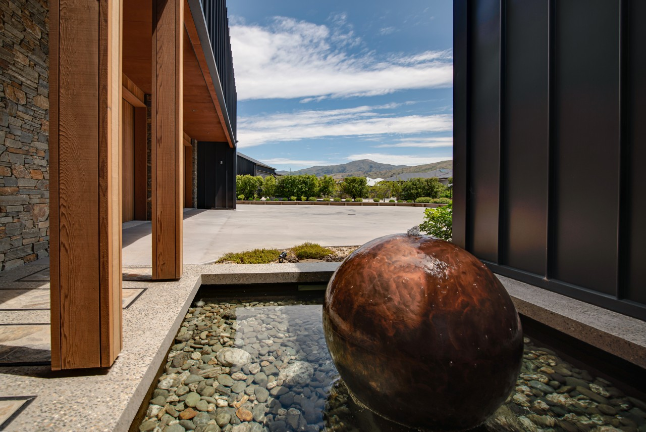 A sculptural ball forms the home's symmetrical water