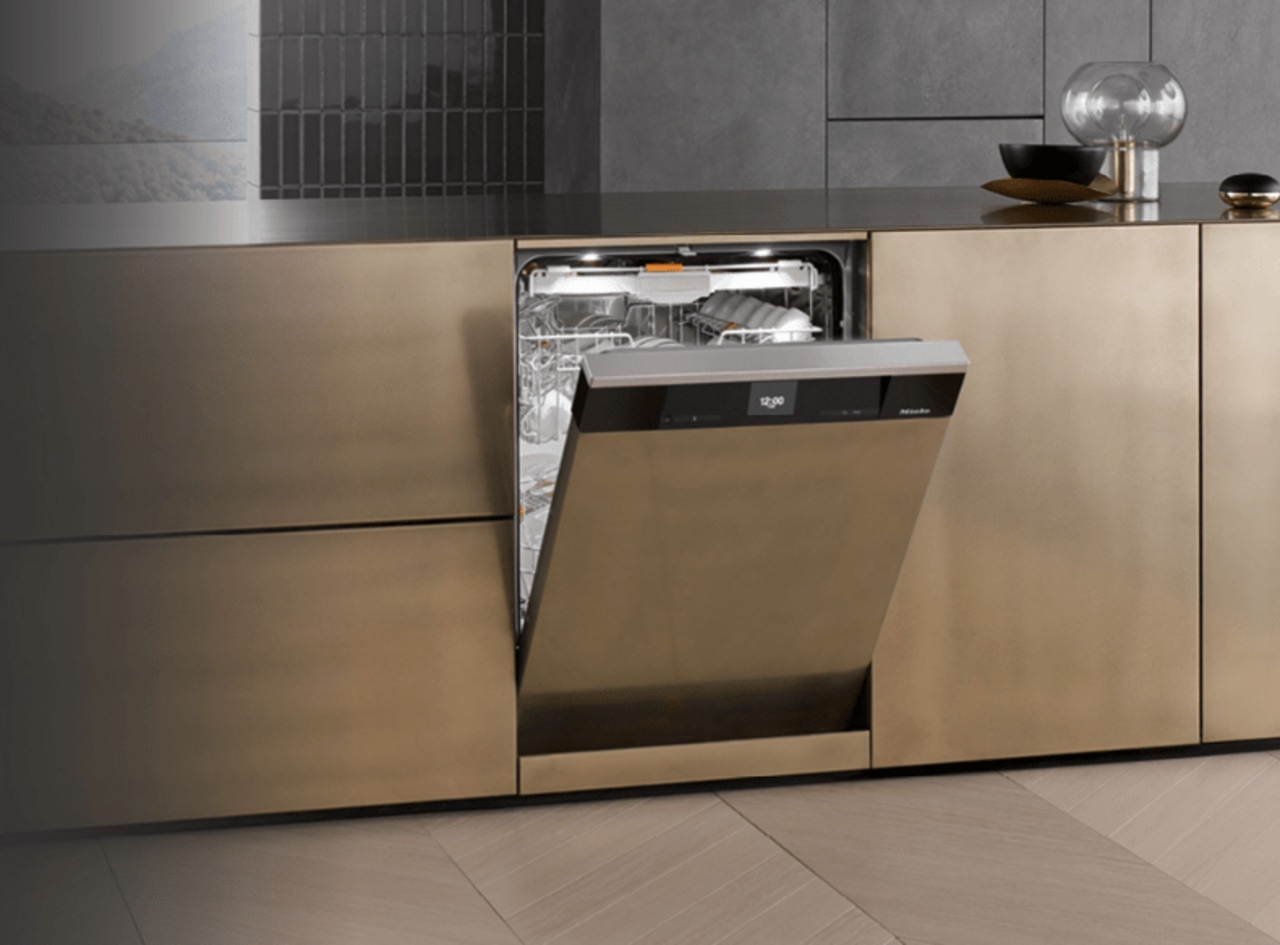 A Miele semi-integrated dishwasher countertop, floor, flooring, furniture, home appliance, kitchen, kitchen appliance, kitchen stove, major appliance, product, sideboard, gray, brown, black