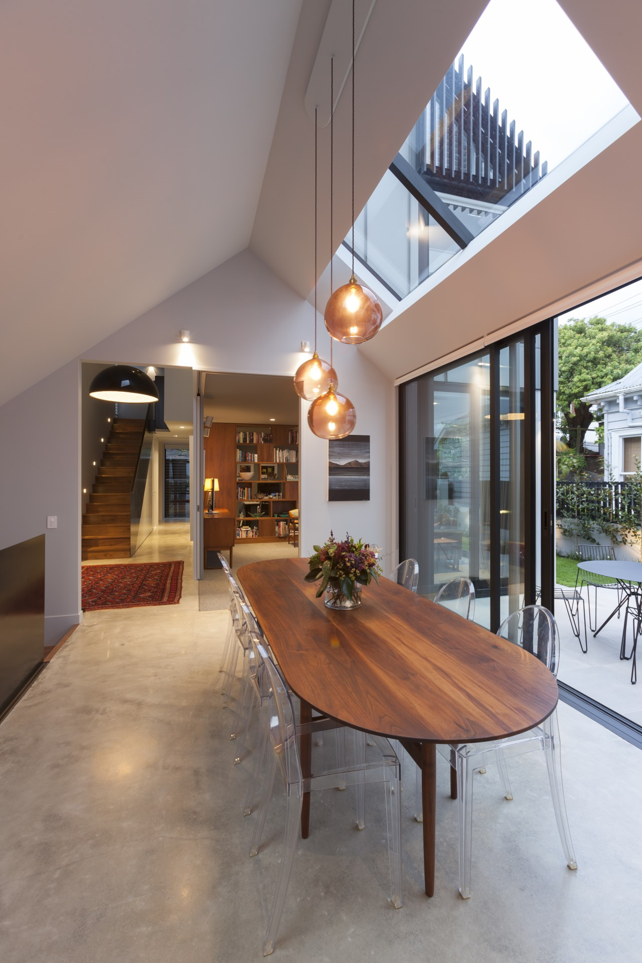 The garden arrangement formed along the northern elevation apartment, architecture, building, ceiling, daylighting, dining room, floor, flooring, furniture, hardwood, home, house, interior design, living room, loft, property, real estate, residential area, roof, room, table, wood, wood flooring, gray