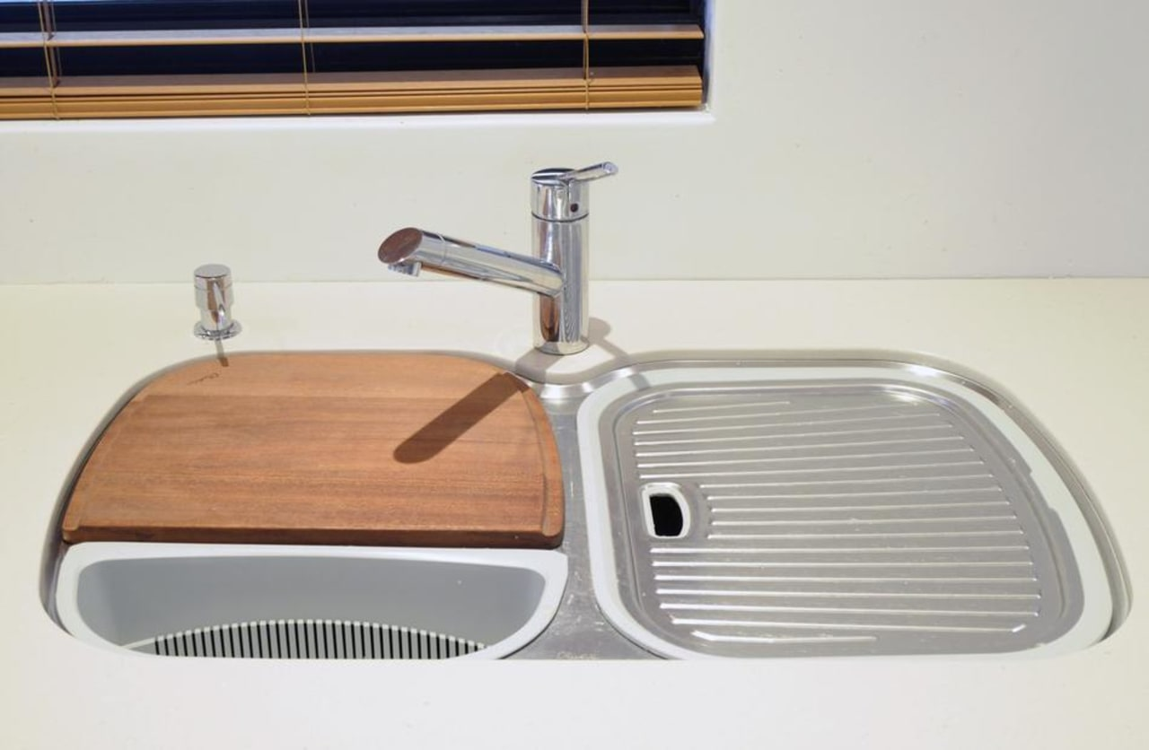This twin basin sink allows you to add hardware, plumbing fixture, product, sink, tap, white
