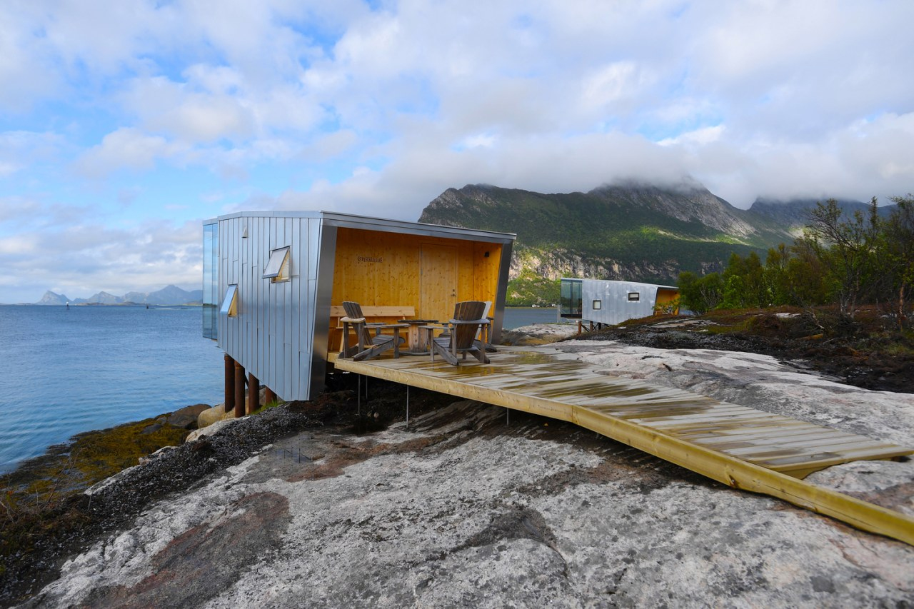The new cabins at Manshausen Island Resort by coast, geological phenomenon, highland, house, mountain, sea, sky, transport, yellow, teal