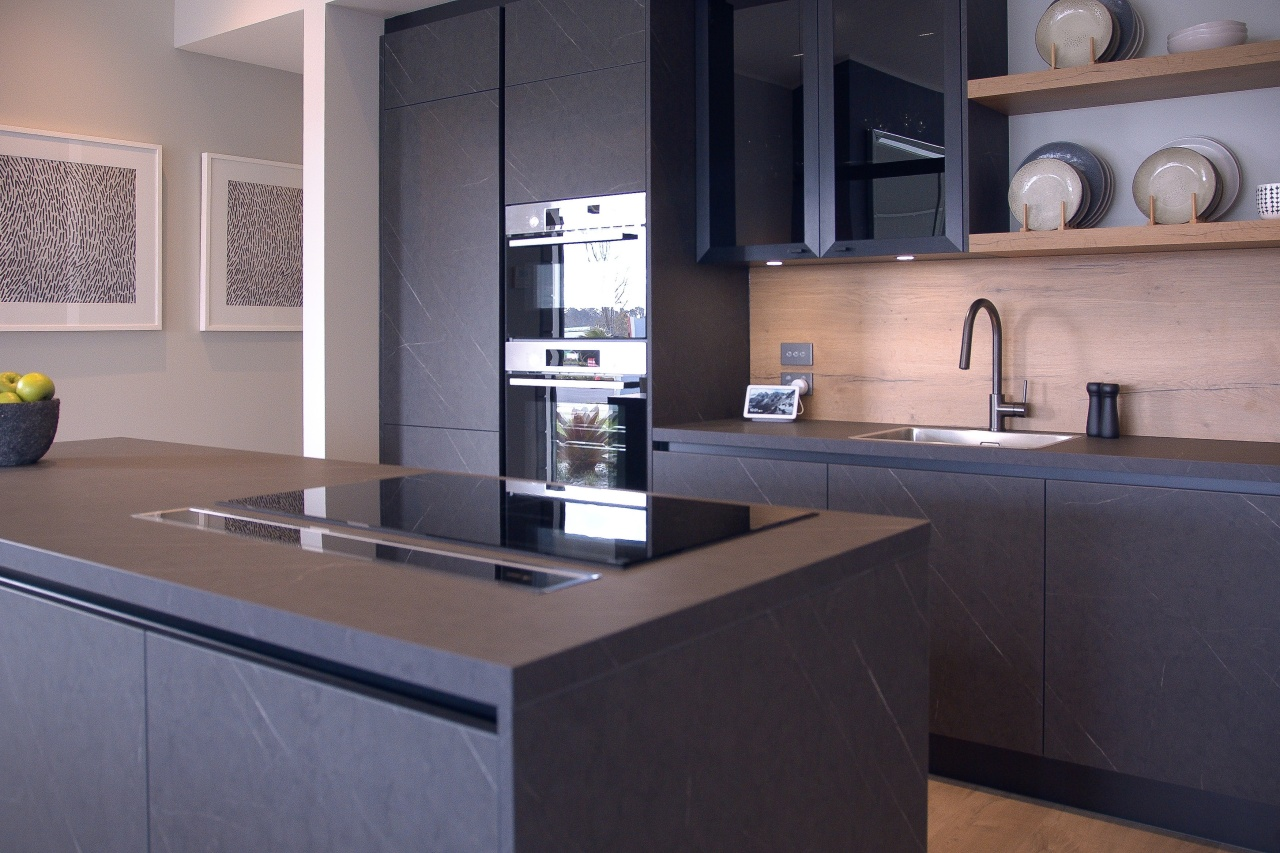 Dark cabinetry finishes are complemented by a generous