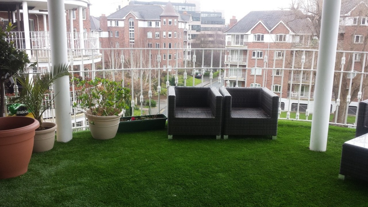 A balcony in Dublin furnished with TigerTurf artificial turf, backyard, chair, flooring, furniture, garden, grass, lawn, outdoor structure, plant, property, shrub, yard, gray, green