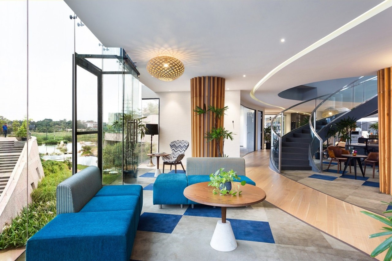 Titan Bangalore Workplace Lounge Purnesh apartment, architecture, balcony, building, ceiling, estate, furniture, home, house, interior design, living room, lobby, property, real estate, room, table, white