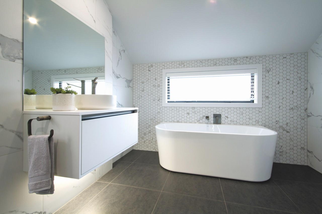 The main bathroom includes a freestanding bath and