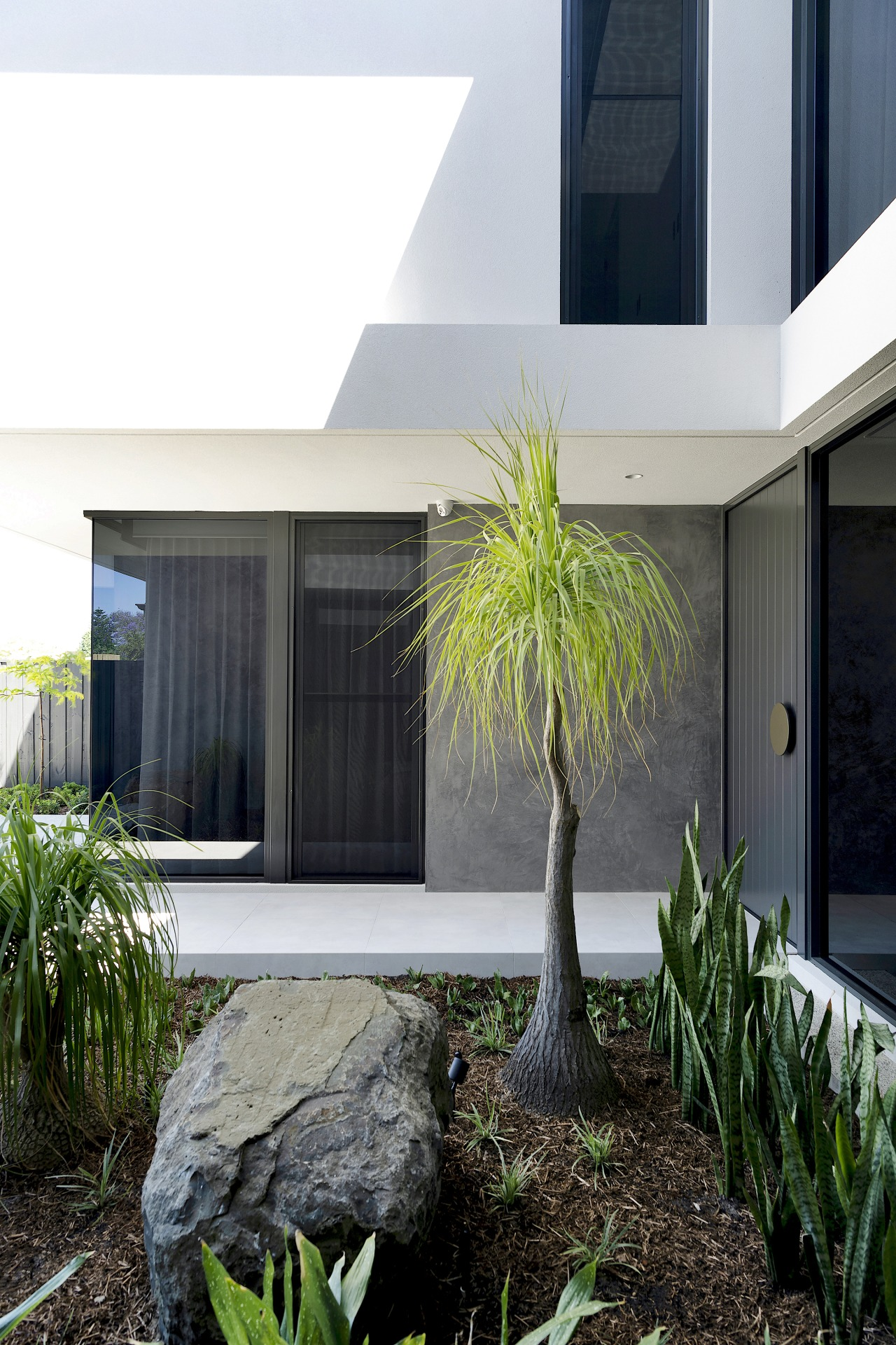 The sculptural entry to the luxurious home.