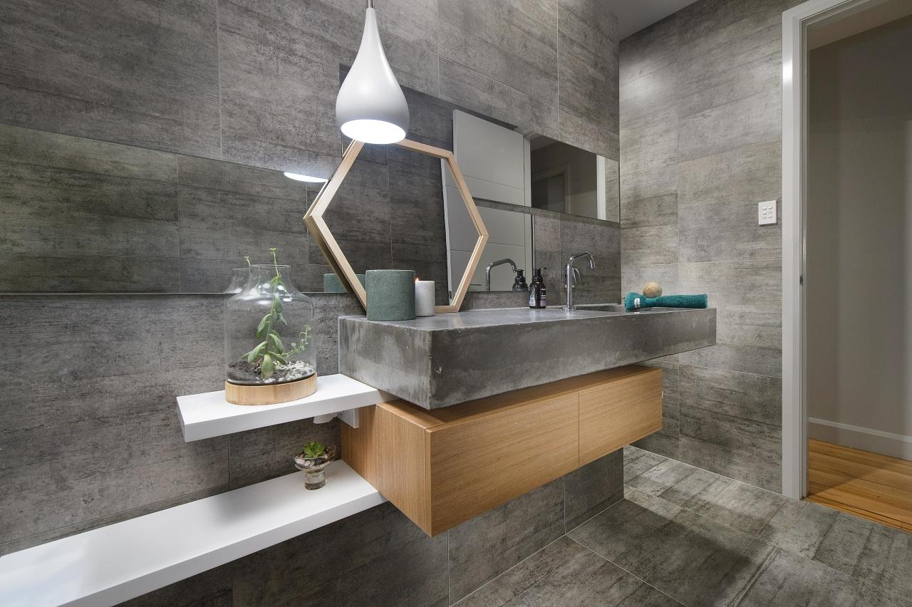 Strong, semi-industrial and minimalist, this family bathroom boasts architecture, bathroom, countertop, floor, flooring, interior design, sink, tile, gray