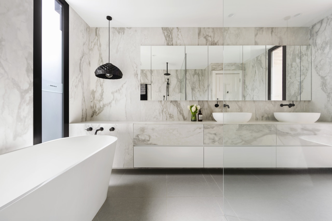 The vanity in this ensuite runs the length architecture, bathroom, floor, flooring, interior design, room, sink, tap, tile, wall, gray