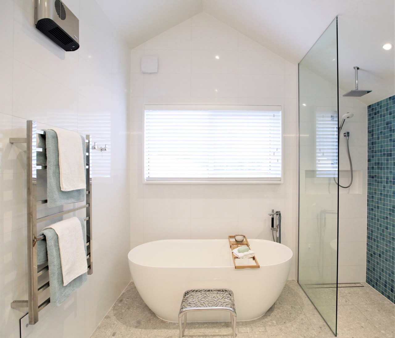 The freestanding tub is straight ahead as you