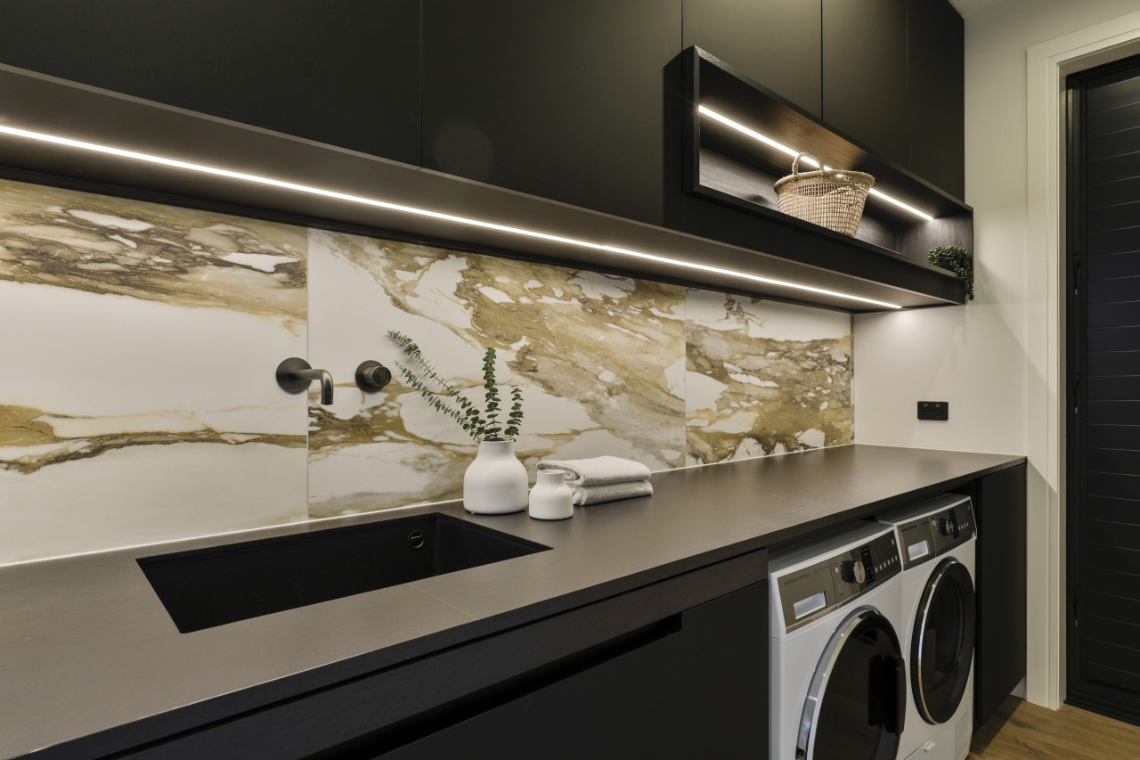 The laundry splashback has been tiled with Macchia