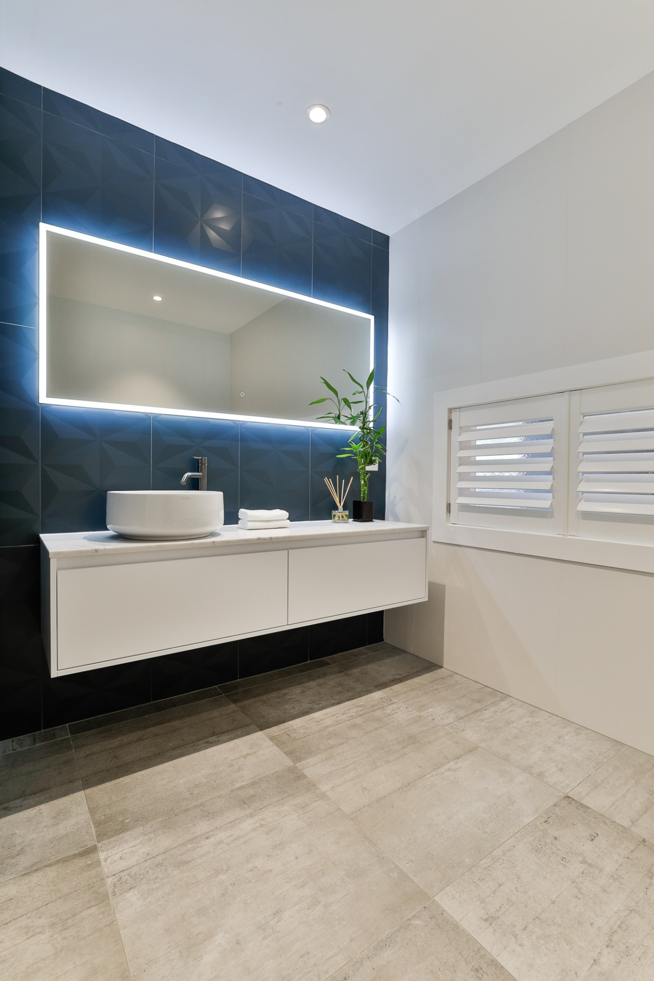 The floors in both the ensuite and bathroom