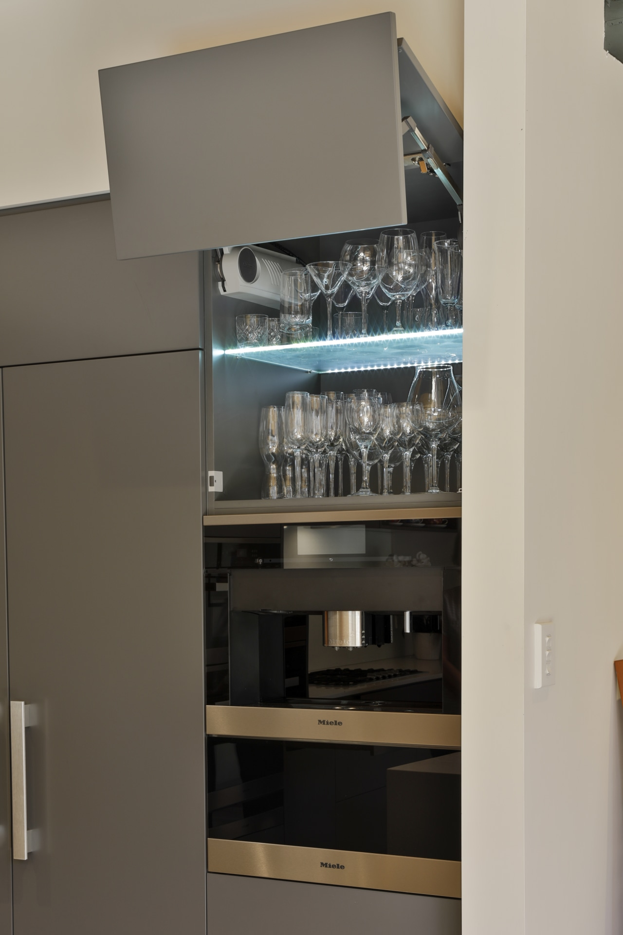Blum Aventos HF hardware lets this high cabinet