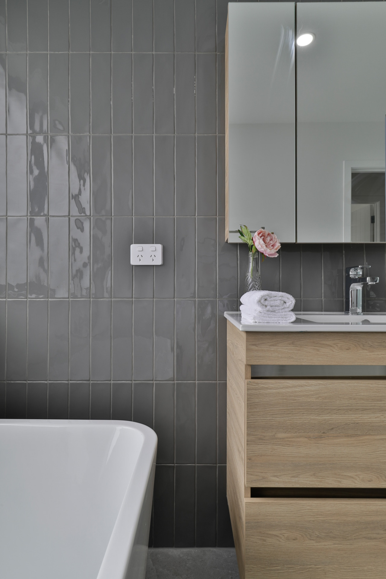 Vertical wall tiles lead the eye up the