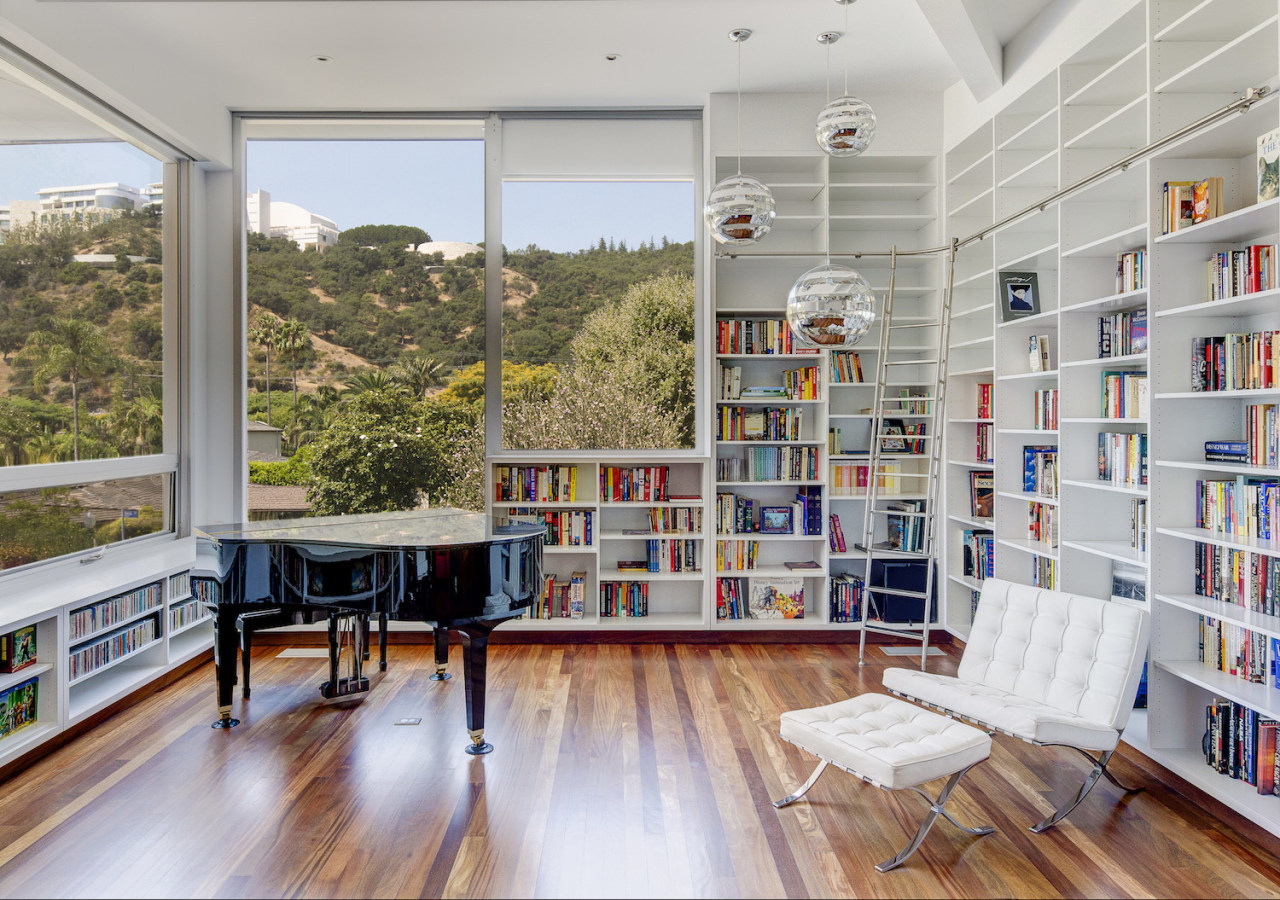 Calling all library fans: This personal library space architecture, bookcase, interior design, library, public library, real estate, shelving, gray