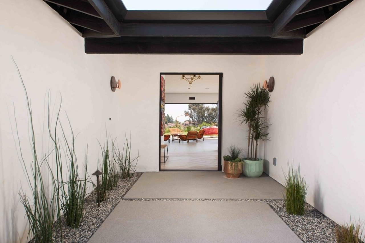 The entrance is well-lit and features plenty of courtyard, estate, home, house, interior design, property, real estate, gray