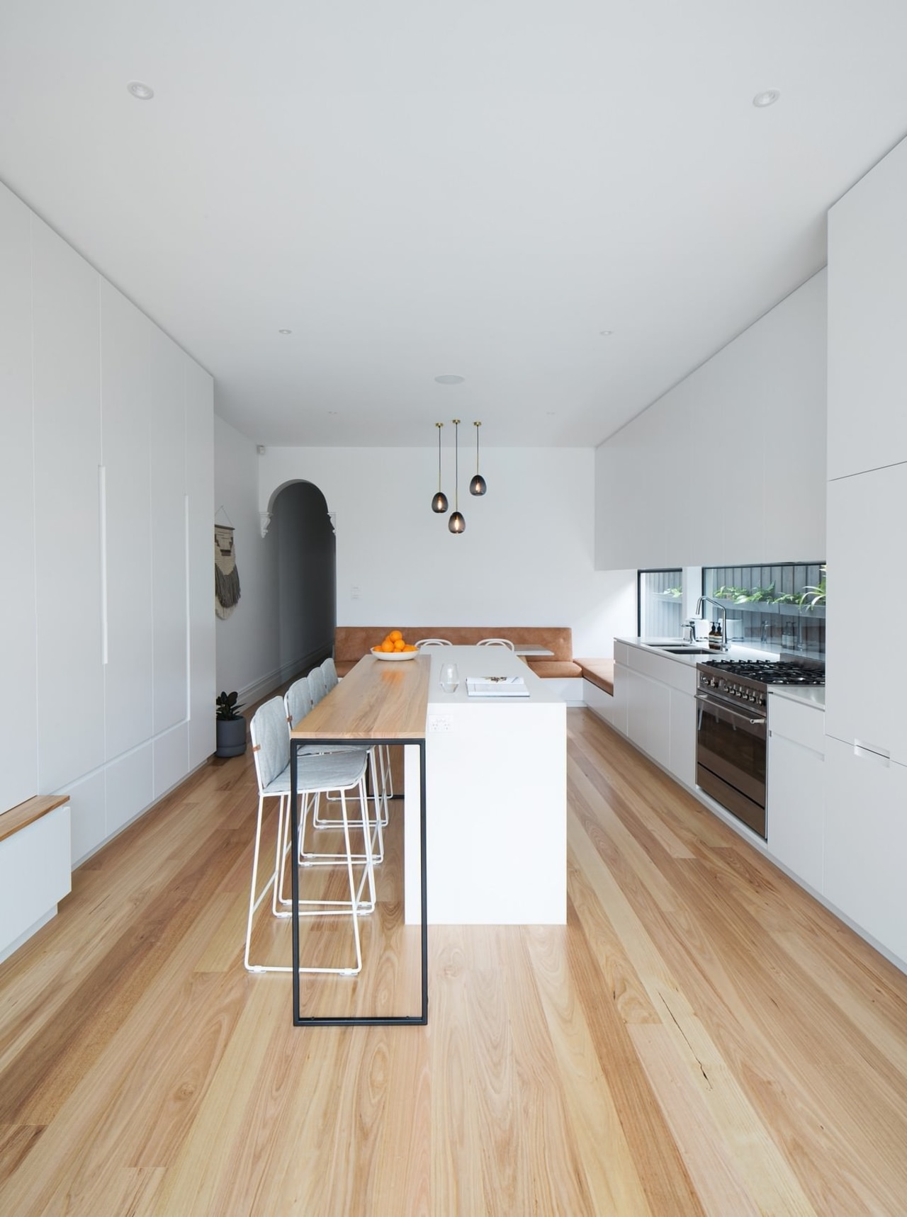 This kitchen features ample storage and dining space architecture, ceiling, daylighting, floor, flooring, hardwood, house, interior design, laminate flooring, property, real estate, wood, wood flooring, white