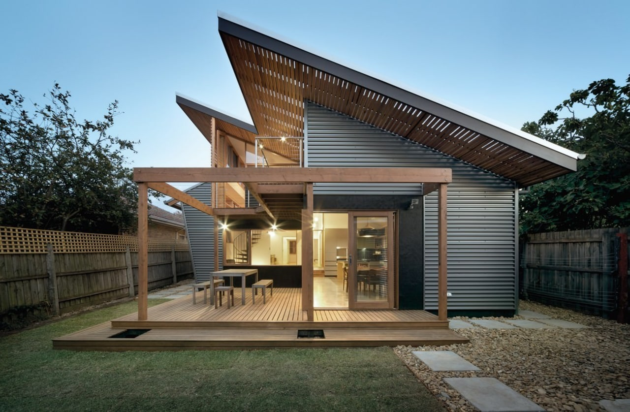 The angled roof is certainly unique architecture, facade, home, house, property, real estate, black
