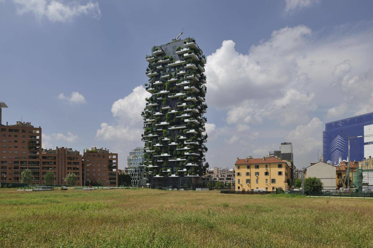 This is definitely a new approach on the building, cloud, condominium, grass, residential area, sky, tower, tower block, tree, gray, brown