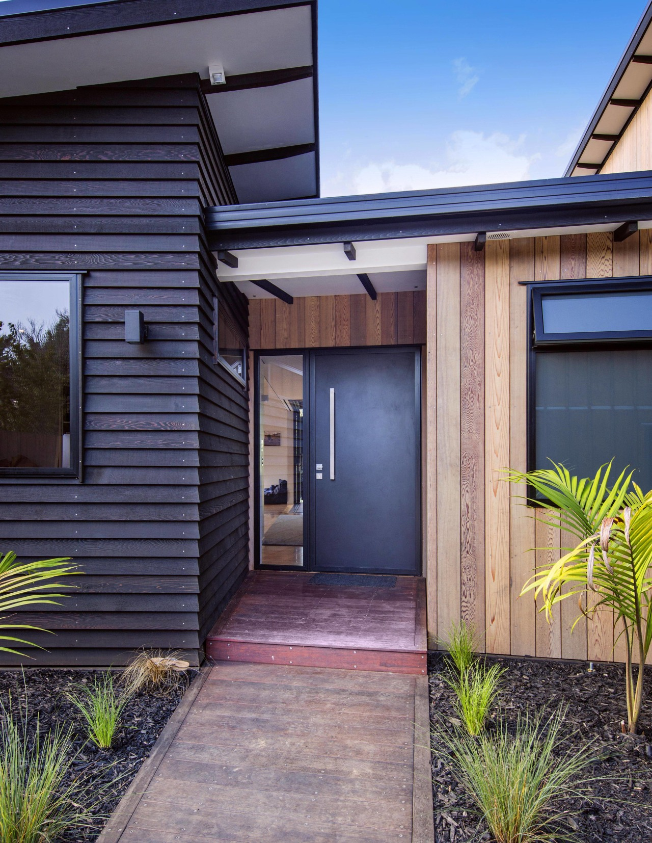 The front of this Waitoki home architecture, backyard, cottage, door, facade, home, house, property, real estate, residential area, siding, window, gray