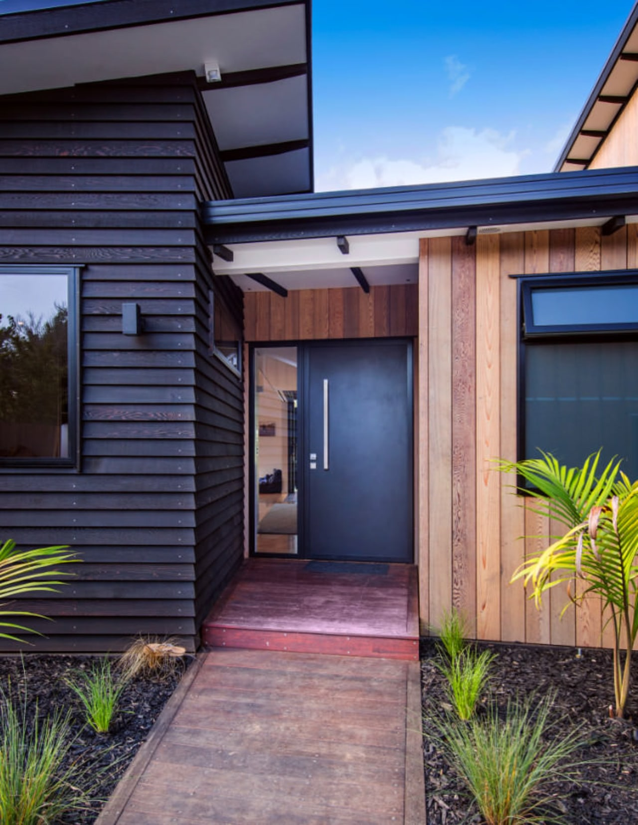 An external shot of the front of the backyard, door, facade, home, house, property, real estate, residential area, siding, window, blue