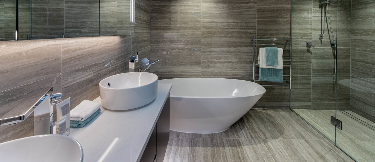 Find out more about 585 Rothesay Bay architecture, bathroom, bidet, floor, flooring, interior design, plumbing fixture, property, room, sink, tap, tile, gray