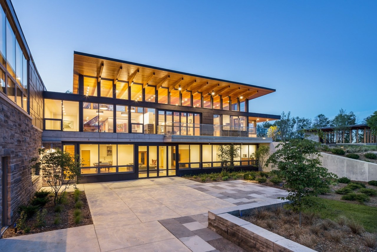The home is certainly substantial – although the architecture, building, condominium, corporate headquarters, estate, facade, home, house, mixed use, property, real estate, residential area, teal