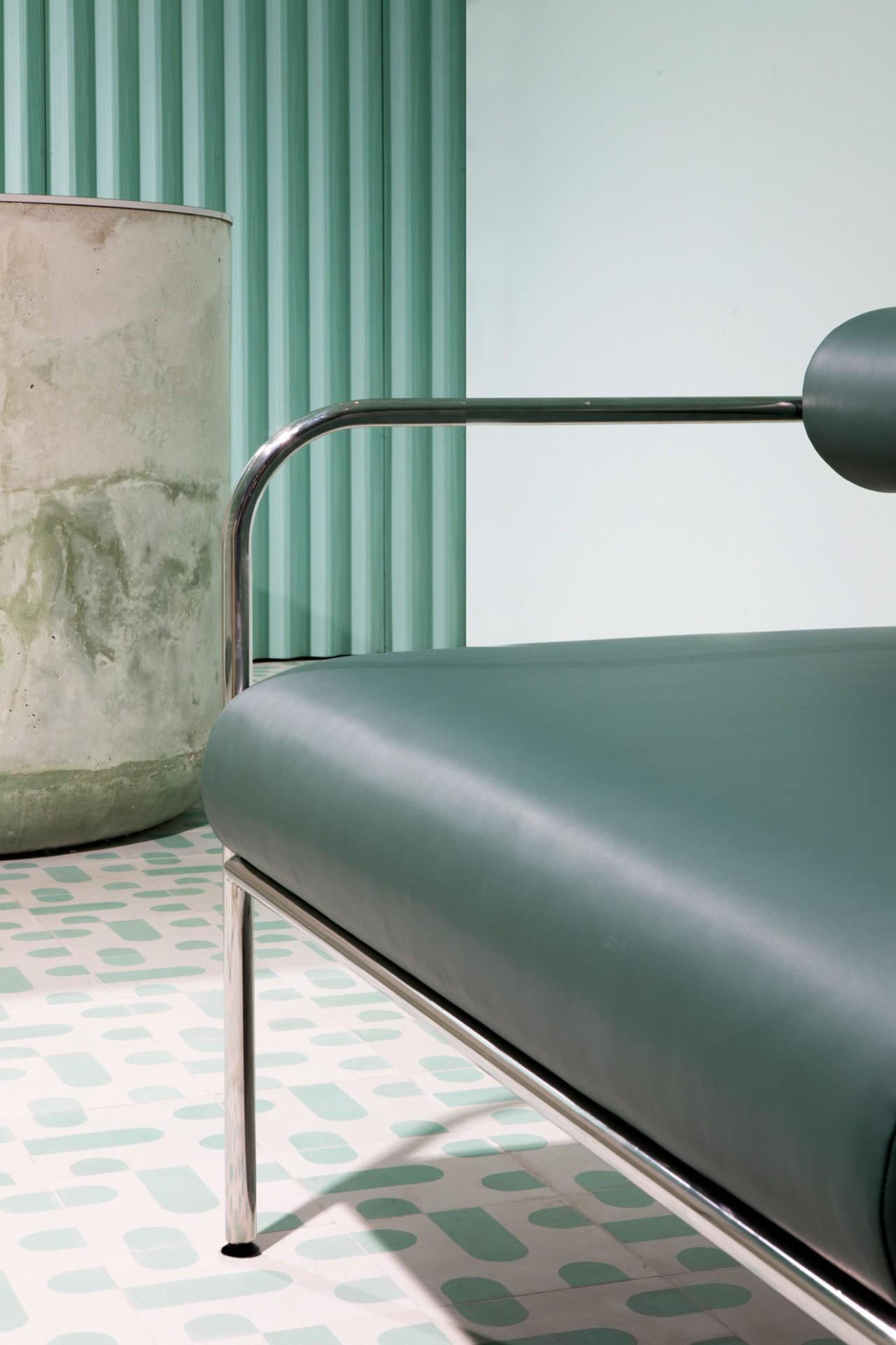 Sergio Mannino Studio designed this pharmacy to be chair, furniture, interior design, lighting, product design, table, white, gray