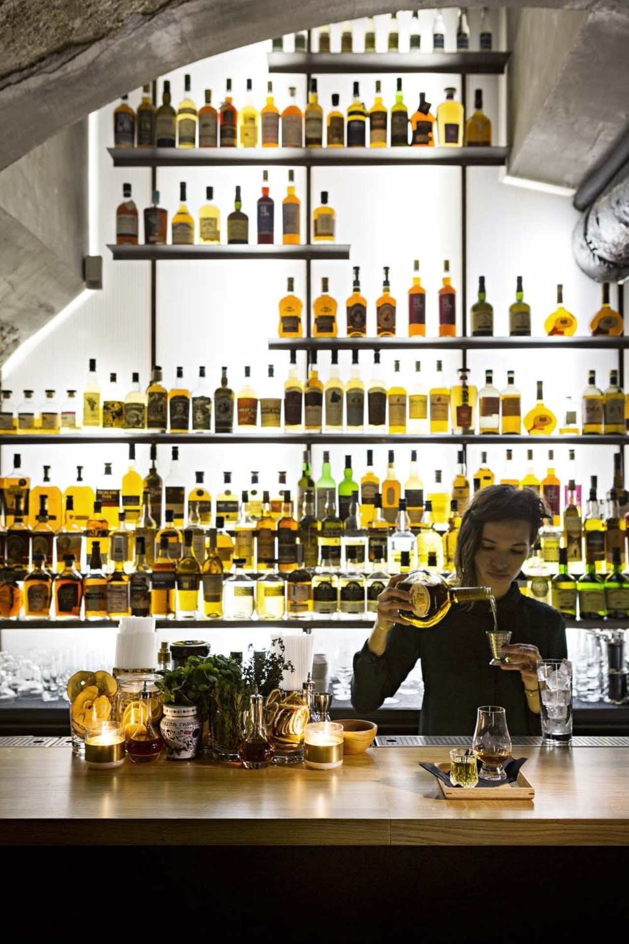 This new whiskey bar takes advantage of a bar, distilled beverage, drink, liquor store, white, black