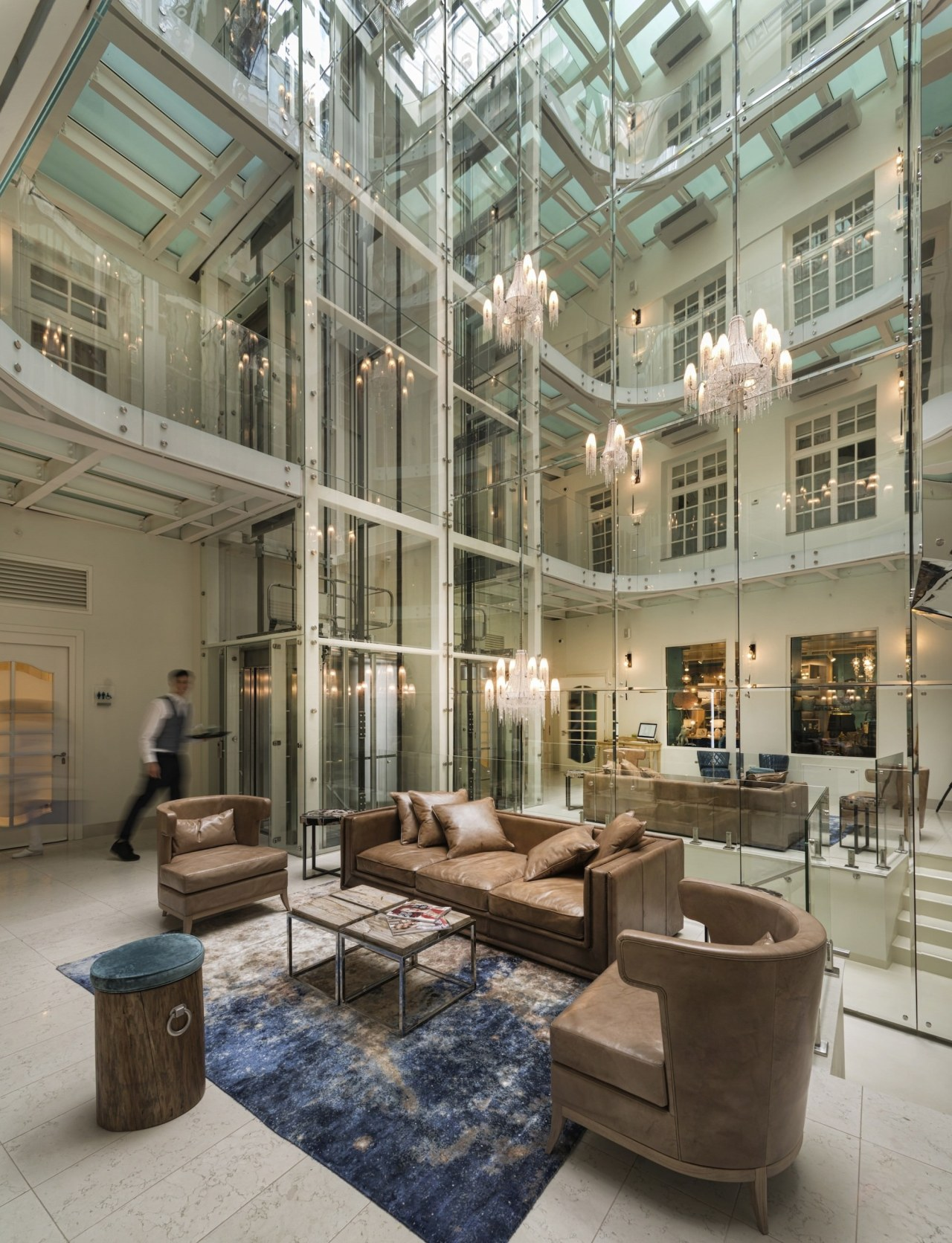 The atrium is a melding of the old daylighting, interior design, lobby, mixed use, gray