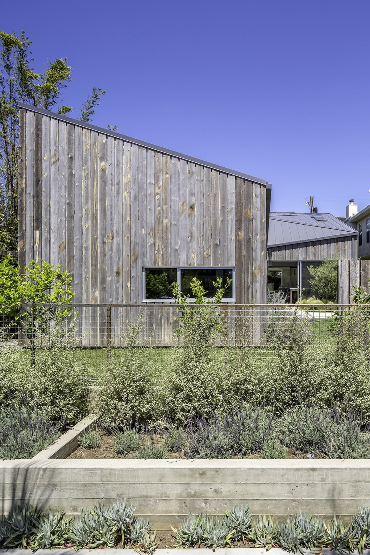 Rustic weatherboards make up the siding on this architecture, building, facade, house, real estate, residential area, gray, blue
