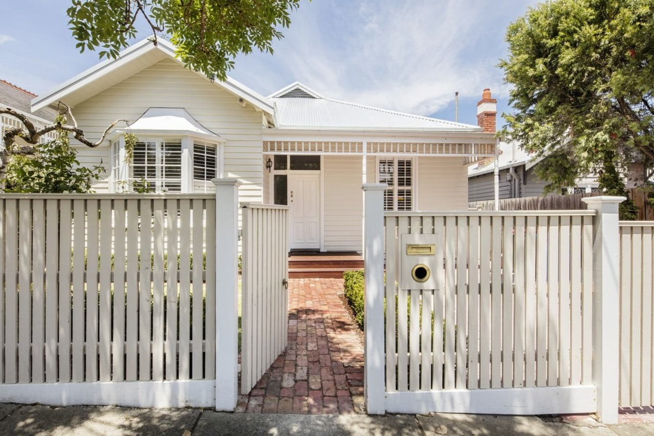 From the street, nothing appears to have changed cottage, estate, facade, fence, gate, home, home fencing, house, outdoor structure, picket fence, property, real estate, residential area, siding, gray