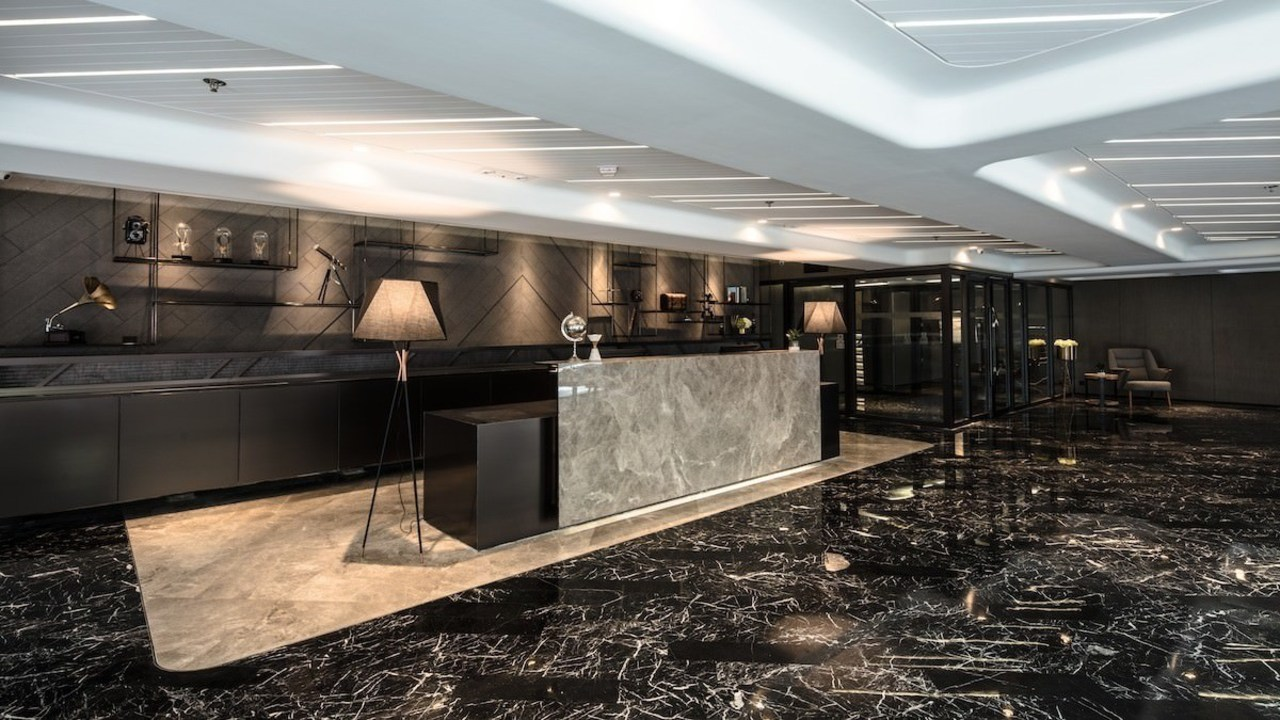 Walking into this lobby is like stepping into ceiling, floor, flooring, interior design, lobby, black