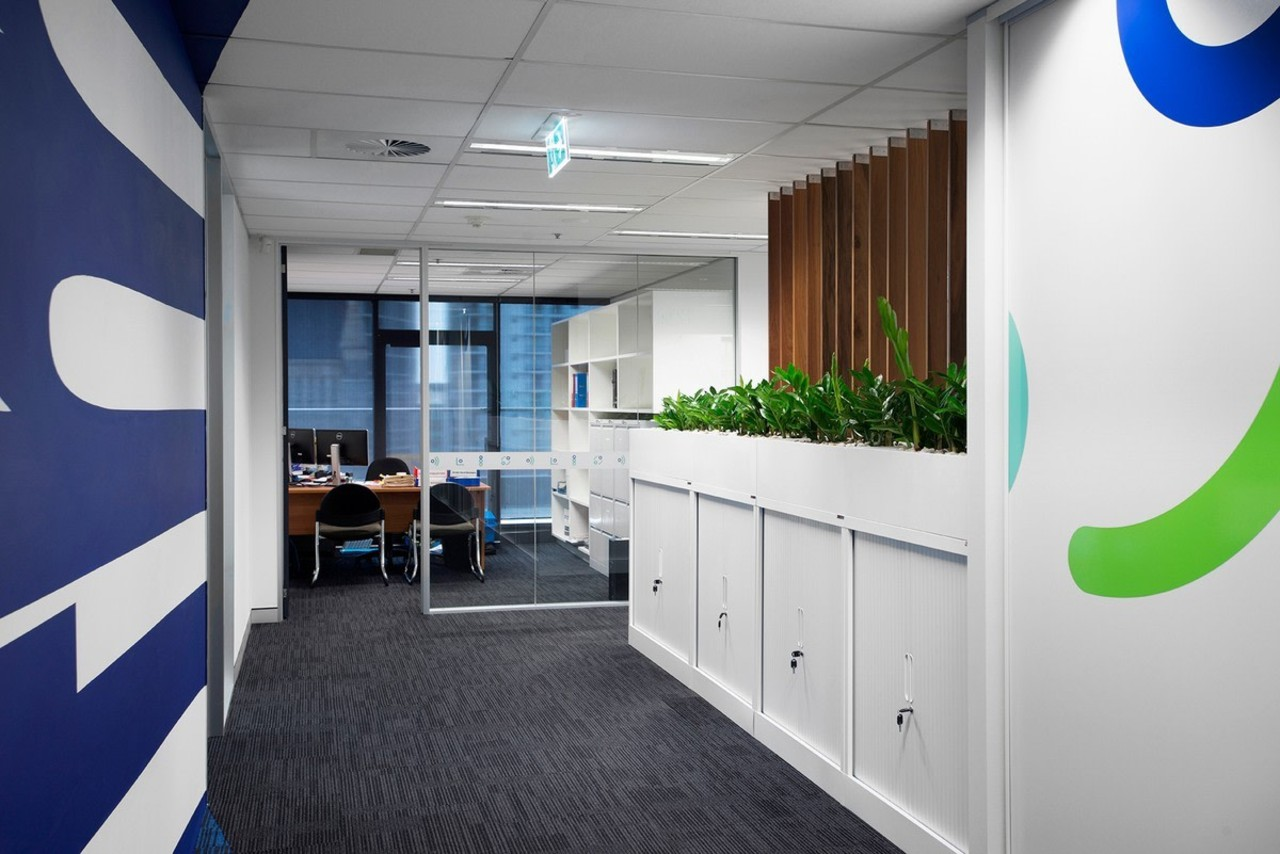 Looking down the hallway toward an office interior design, office, product design, gray, white