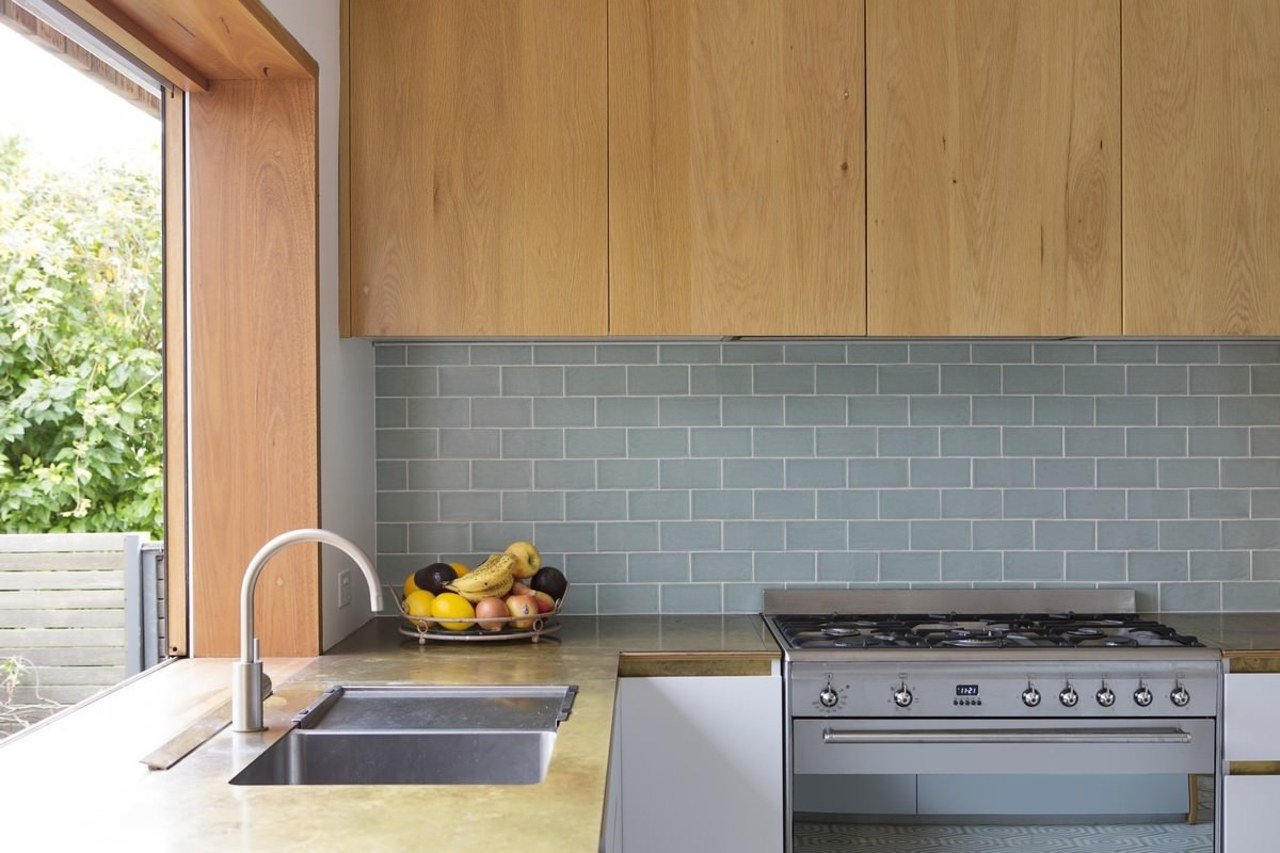 An under-cabinet rangehood maintains a clean look in architecture, countertop, floor, flooring, home, interior design, kitchen, real estate, tile, wall, gray