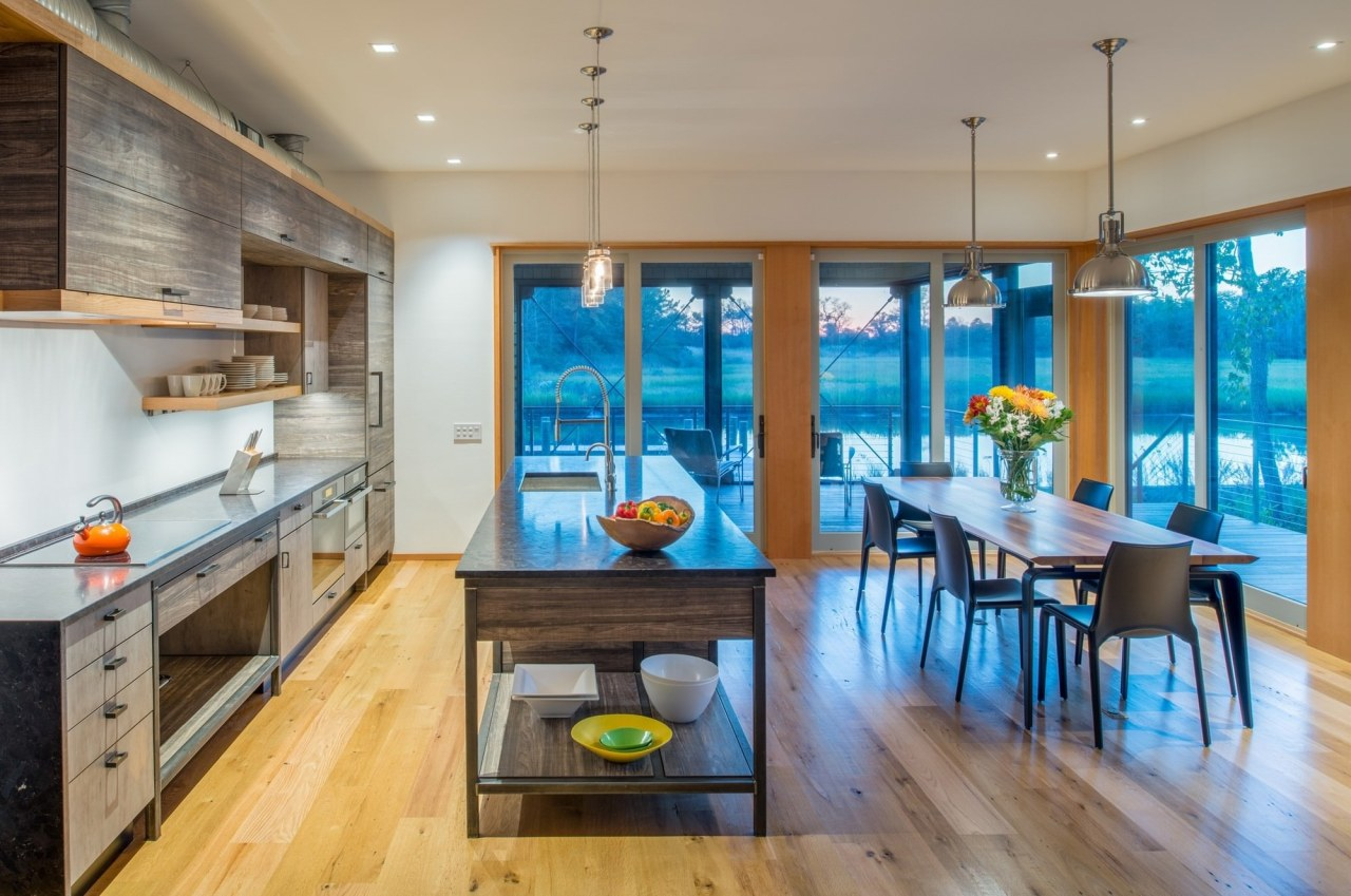 Sitting at the dining table, you have views countertop, dining room, interior design, kitchen, real estate, room, gray