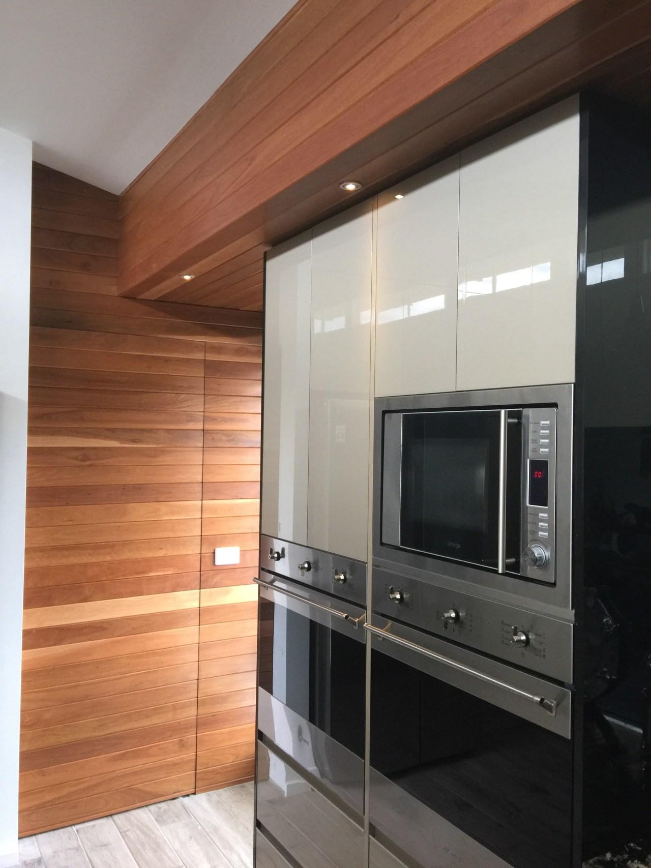 Centre Stage cabinetry, countertop, floor, flooring, home appliance, interior design, kitchen, major appliance, wood flooring, gray, brown