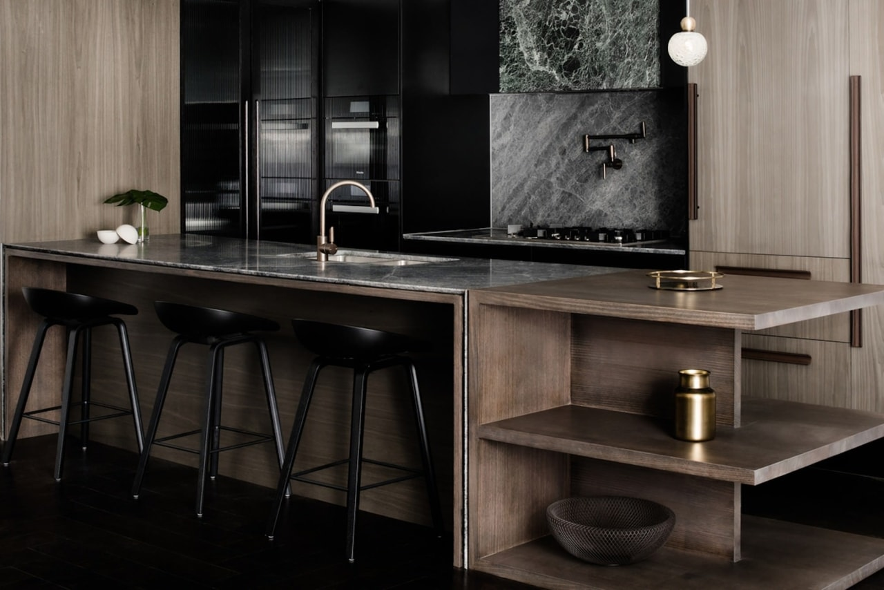 This island is perfect for an apartment, featuring cabinetry, countertop, floor, flooring, furniture, interior design, kitchen, sink, table, black, gray