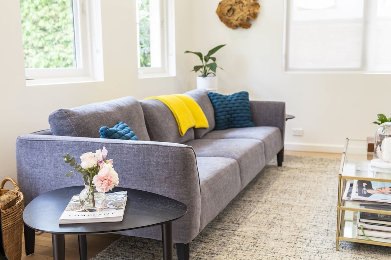 A closer view of the interior decoration couch, floor, furniture, home, interior design, living room, room, sofa bed, table, white