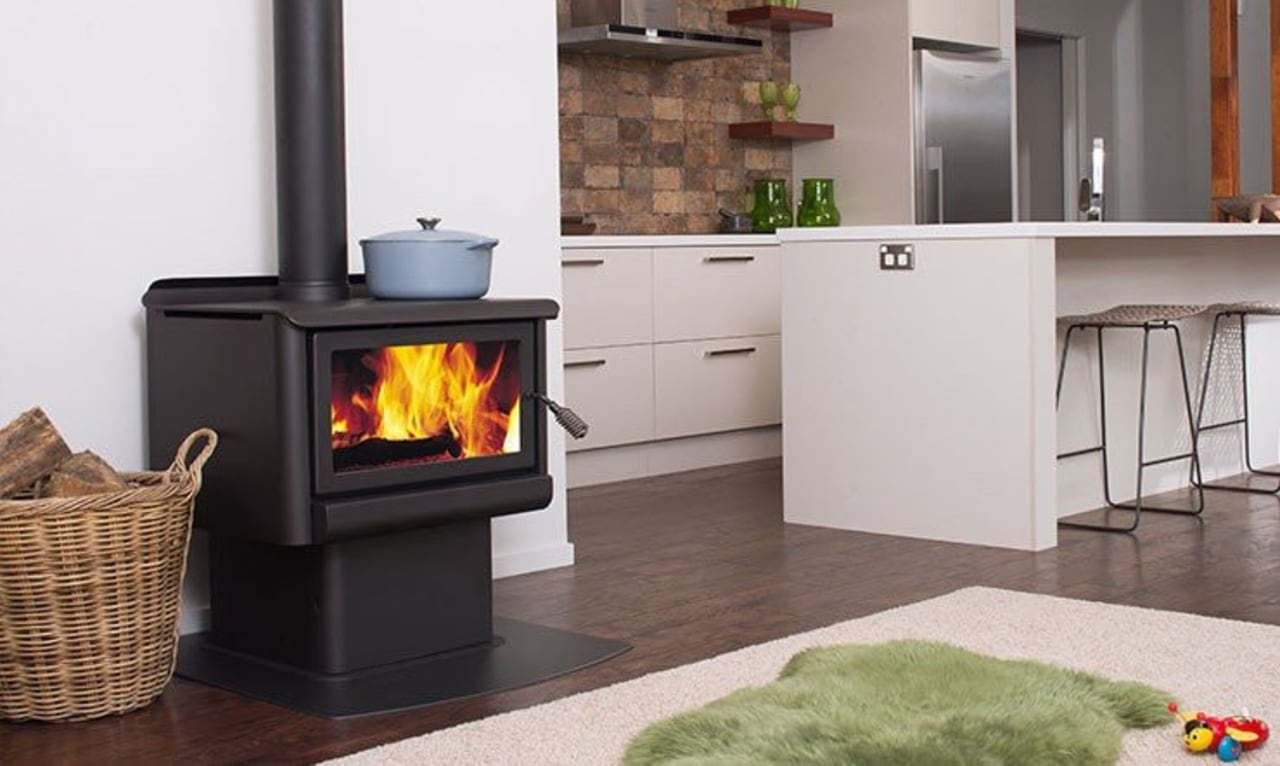 It's better to run a smaller appliance harder fireplace, hearth, heat, home appliance, major appliance, product, product design, stove, wood burning stove, gray