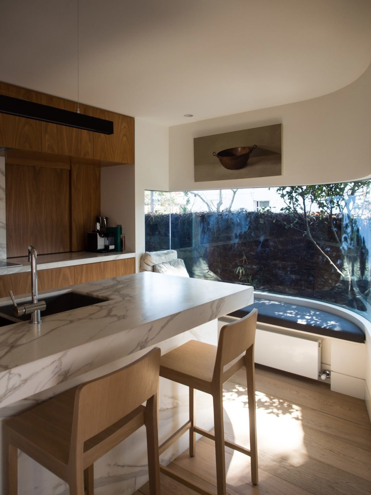 The kitchen isn't overwhelming – the architect opted architecture, countertop, house, interior design, kitchen, real estate, room, table, brown, gray