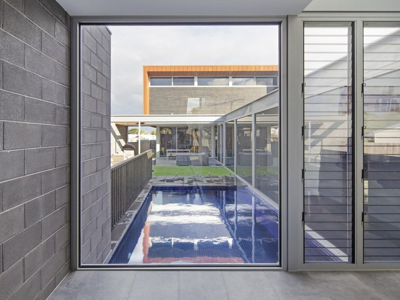 This hall window faces down onto the pool daylighting, door, glass, house, real estate, window, gray
