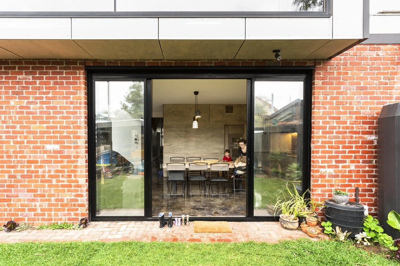 A view from the yard into the kitchen/dining courtyard, door, facade, home, house, porch, real estate, window, white