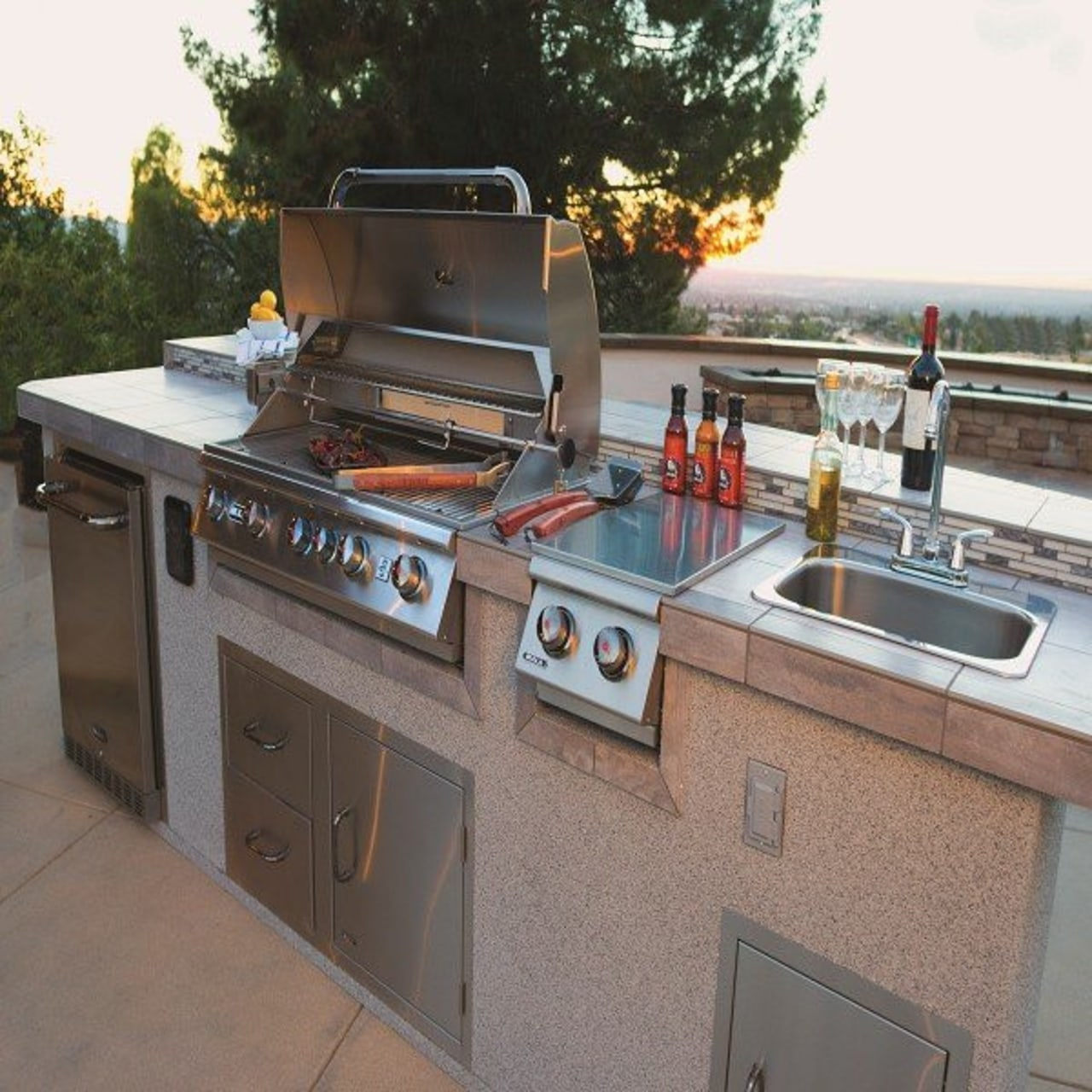 A barbecue is a welcome addition to any barbecue grill, countertop, kitchen, kitchen appliance, outdoor grill, gray